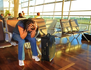 depressed-woman-airport-delay