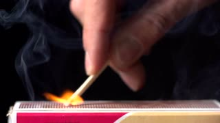 slow-motion-of-lighting-a-match-close-up-of-hands-with-match-and-striking-f_4nw71bgnx__S0007